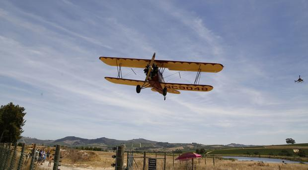 A vintage plane comes in for its landing at the airport near the town of Stellenbosch, South Africa. (AP/Schalk van Zuydam)