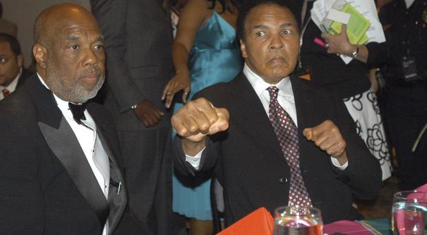 Photographer Howard Bingham, left, and Ali at a reception at the Muhammad Ali Centre in Louisville, Kentucky, in 2006. (AP)
