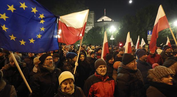 Protesters outside the Parliament building in Warsaw, Poland on Friday
