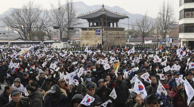 Supporters of impeached South Korean President Park Geun-hye march during a rally opposing her impeachment in Seoul (AP)