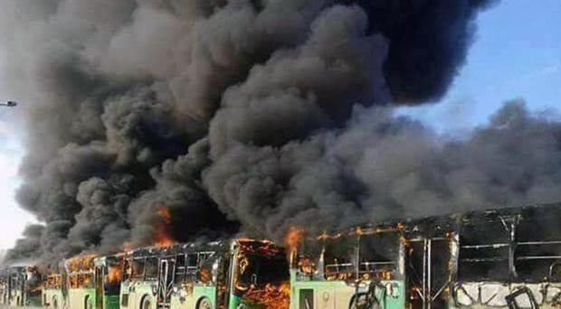 Government evacuation buses in Idlib province are set ablaze (SANA/ AP)