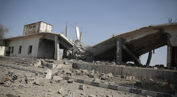 The aftermath of a Saudi-led air strike near the al-Saleh mosque in Sanaa (AP)