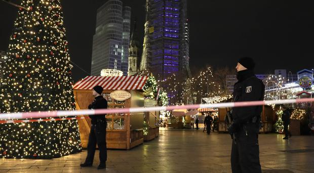 Police guard a Christmas market in Berlin. (AP/Michael Sohn)