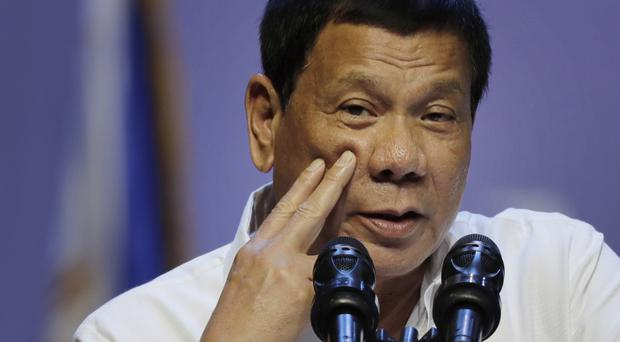 Mr Duterte's crackdown on drugs has left thousands of people dead (AP)