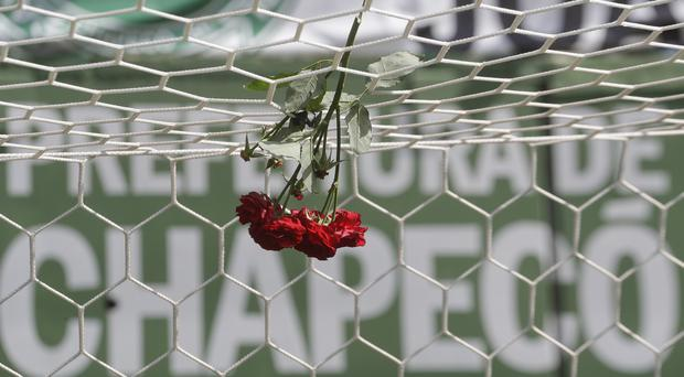 Flowers hang from a soccer net at the Arena Conda stadium in Chapeco, Brazil (AP)