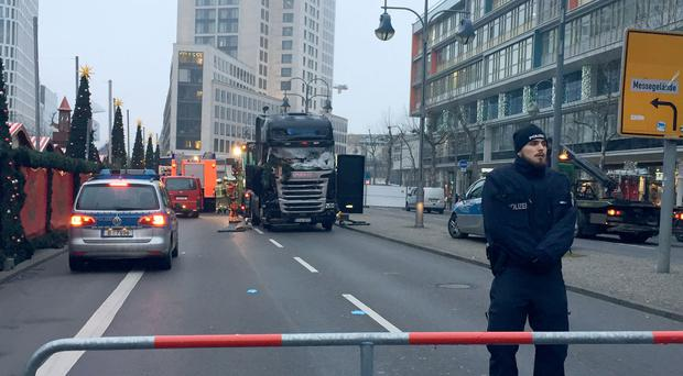 The scene after a truck ploughed into a crowded Christmas market in Berlin