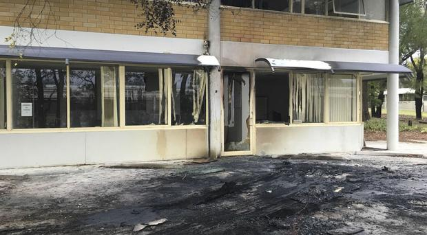 The damaged front of the Canberra office of the Australian Christian Lobby after a van slammed into it (Belinda Merhab/AAP/via AP)