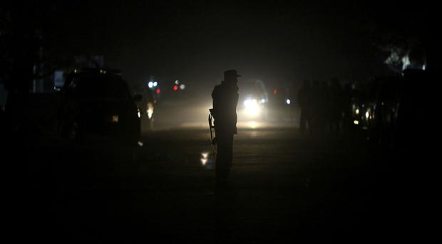 Security forces patrol the site of attack on an Afghan parliament member's house in western Kabul, as another politician's home has been targeted (AP/ Rahmat Gul)