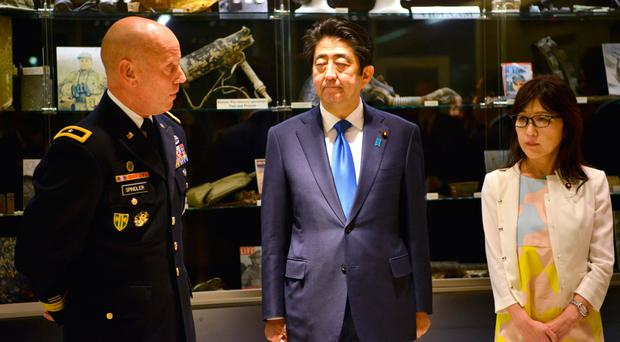 US Army Brigadier General Mark Spindler (left) briefs Prime Minister Shinzo Abe of Japan and Defense Minister Tomomi Inada (right)