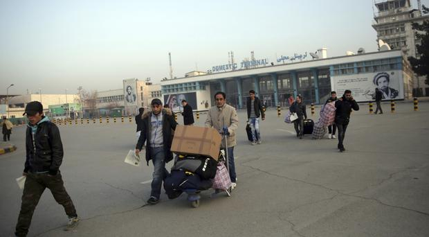 Afghans who were deported from Germany exit the Kabul International Airport (AP)