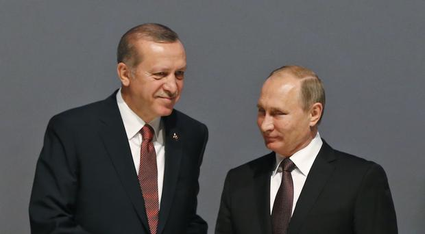 Mr Putin said Russia and Turkey will act as guarantors to the peace deal (AP)