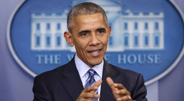 US president Barack Obama imposed sweeping punishments in retaliation for Russia's hacking of American political sites and email accounts (AP)