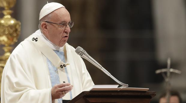 Pope Francis celebrates a New Year mass in St Peter's Basilica at the Vatican (AP/Andrew Medichini)