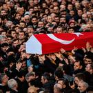 People carry the coffin of 23-year-old victim Yunus Gormek
