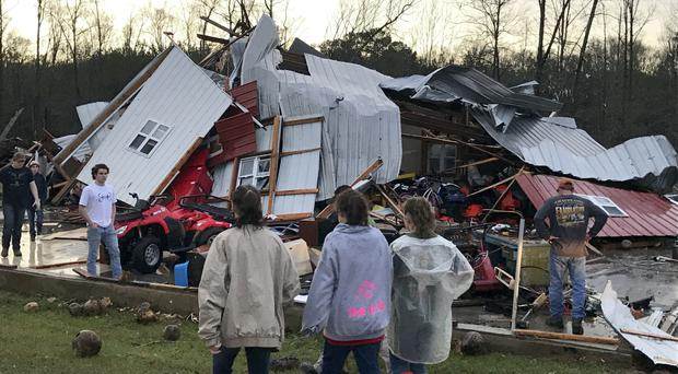 Residents examine the damage in Mount Olive, Mississippi (WDAM-TV/AP)