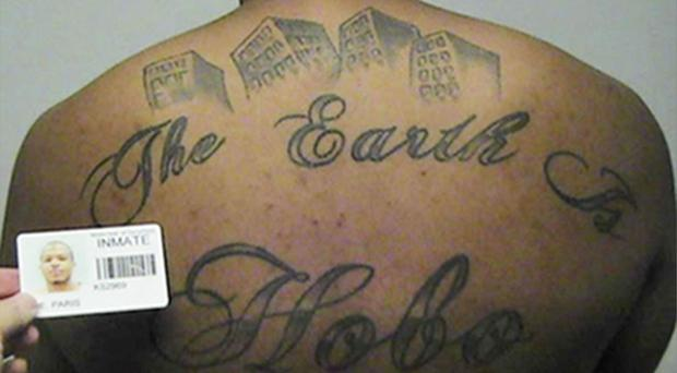 Paris Poe's back tattoo that reads The Earth Is Our Turf, and Hobo (United States Attorney's office in Chicago/AP)