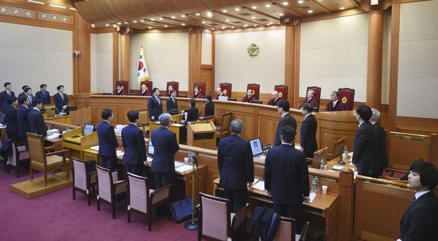 Nine judges of the Constitutional Court sit during a hearing on whether to confirm the impeachment of President Park Geun-Hye (Jung Yeon-Je/Pool Photo via AP)