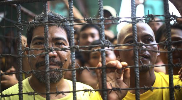 Filipino inmates remain in their cell at the North Cotabato District Jail in Kidapawan city after a massive jailbreak (AP)