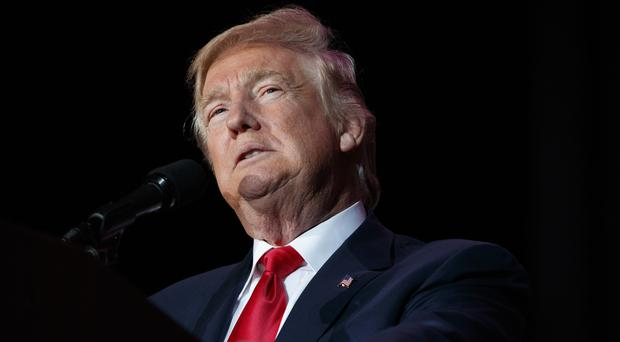 Donald Trump sent a series of provocative tweets before his key meeting with intelligence officials (AP/Evan Vucci)