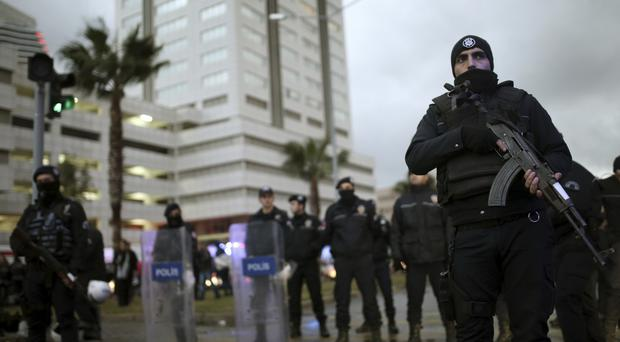 Police officers at the site of the explosion in Izmir, Turkey (AP)