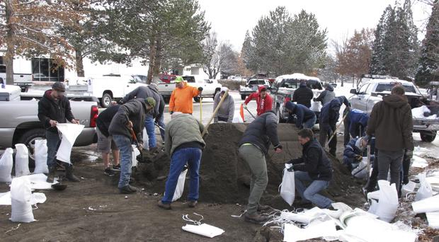 City crews help local business owners fill sandbags in the Sparks Industrial Park in Sparks, Nevada (Scott Sonner/AP)