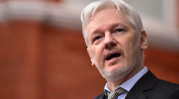 WikiLeaks' Julian Assange said US intelligence officials should be embarrassed by the 25-page, declassified document on hacking