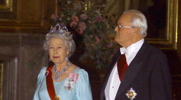 The Queen walks with then German president Roman Herzog through Waterloo Chamber prior to a state dinner held at Windsor Castle
