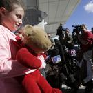 Courtney Gelinas after being reunited with her bear Rufus (Lynne Sladky/AP)