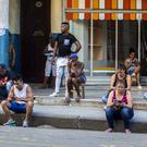 People use a public wi-fi hotspot in Havana (AP)