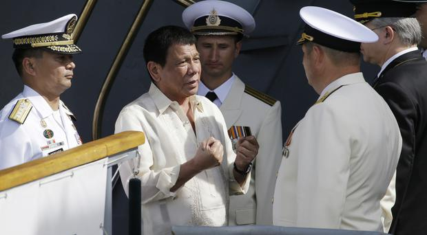 Philippine president Rodrigo Duterte, pictured centre on a visit to Russian warships in Manila, says civilian casualties are 'collateral damage' (AP)