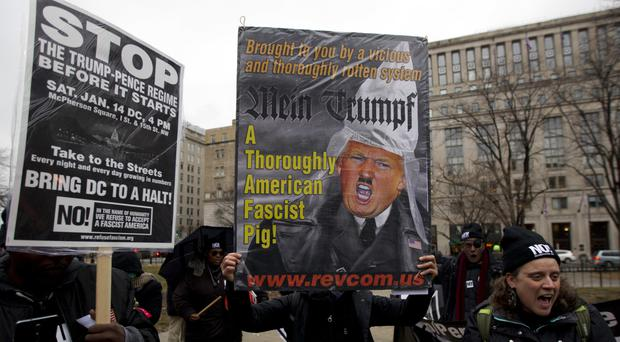Anti-Trump demonstrators make their views known at McPherson Square in Washington (AP)