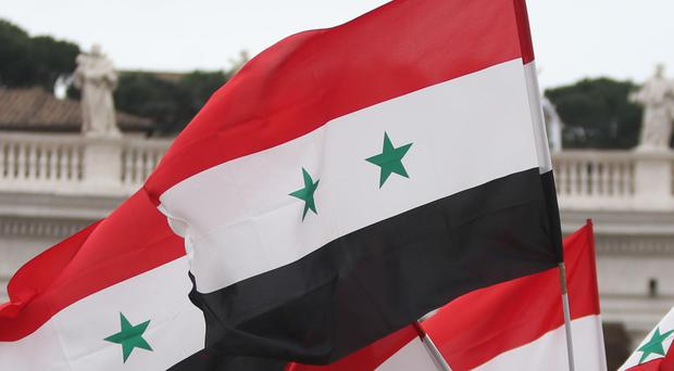 The Syrian Civil Defence also put the death toll at 12, saying the shelling hit a displaced people's centre