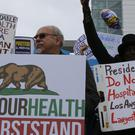 Health care workers demonstrate outside LAC+USC Medical Centre in Los Angeles (AP)