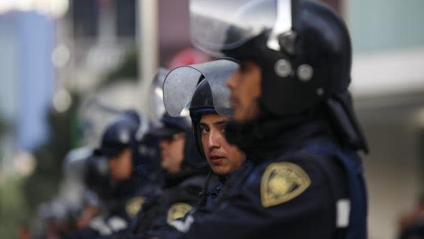 A Mexican police officer said a gunman has killed at least five people and wounded nine others at a nightclub in the Playa del Carmen resort (AP/Marco Ugarte)
