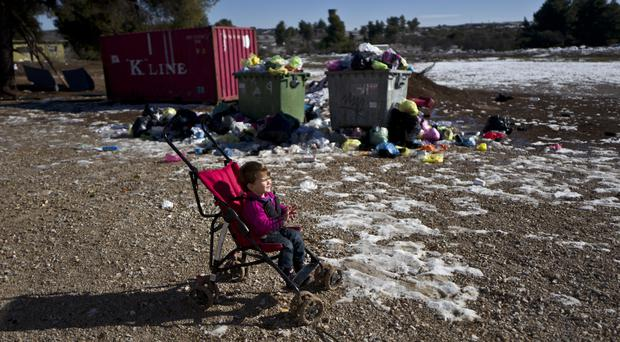 A refugee from Aleppo, Syria, at a camp north of Athens (AP/Muhammed Muheisen)