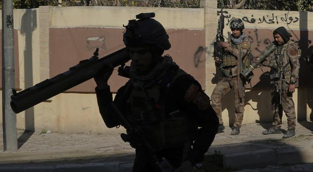 Iraq's special forces troops prepare to battle Islamic State militants in the eastern side of Mosul (AP)