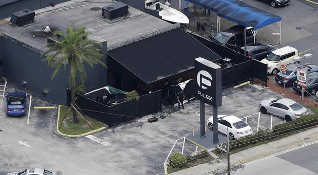 Law enforcement officials work at the Pulse gay nightclub in Orlando following the mass shooting (AP)