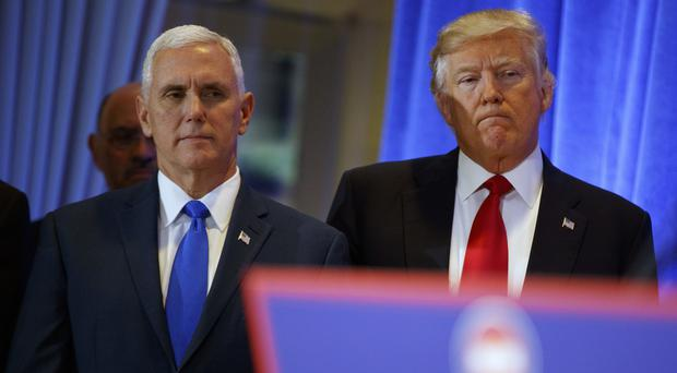 Donald Trump and Mike Pence will attend the traditional inaugural lunch in the Capitol shortly after their swearing-in (AP/Evan Vucci)
