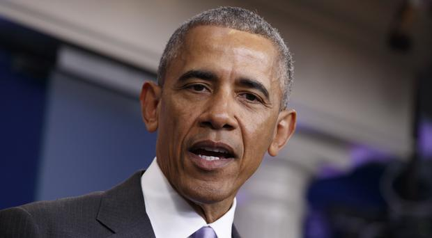 Barack Obama has commuted the sentence for 209 inmates (AP)