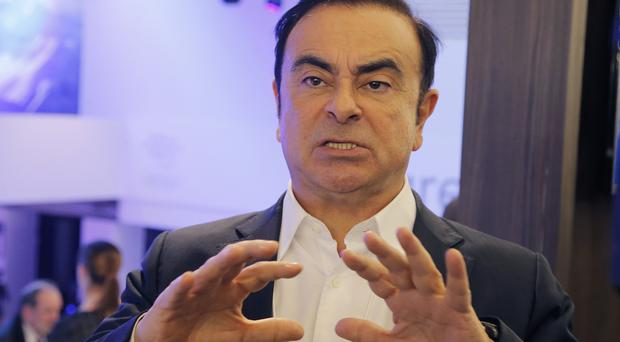 Carlos Ghosn is attending the World Economic Forum in Davos, Switzerland (AP/Michel Euler)