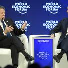 Colombian President Juan Manuel Santos, left, speaks next to Norwegian foreign minister Brende Borge. (AP)