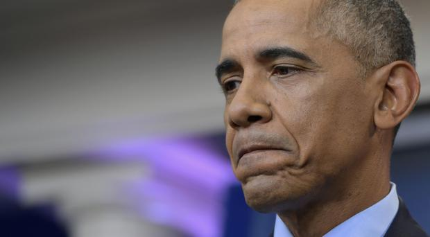 President Barack Obama pauses during his final presidential news conference. (AP)