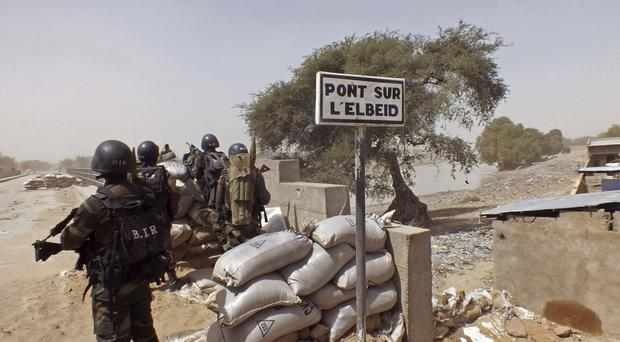 Cameroon soldiers stand guard at a lookout post as they take part in operations against Boko Haram (AP)