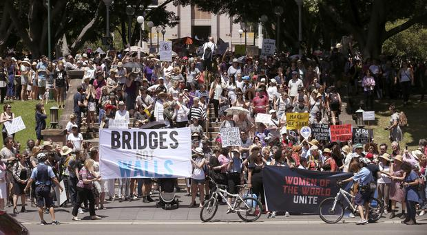 People gather at Hyde Park during the Women's March rally in Sydney against Donald Trump (AP Photo/Rick Rycroft)