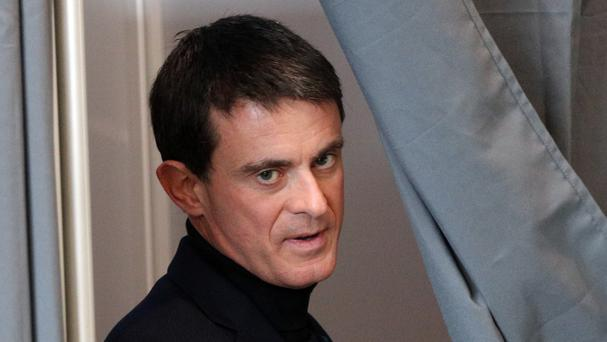 Former French prime minister Manuel Valls leaves the voting booth. (AP/Christophe Ena)
