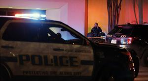 San Antonio police stand guard at the Rolling Oaks Mall after a fatal shooting Sunday (AP Photo/Eric Gay)