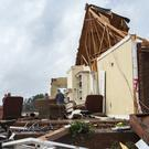 A man sits in what used to be his home, after violent storms hit southern US states (AP Photo/Branden Camp)