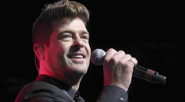 Robin Thicke is involved in a bitter custody battle with his ex-wife (Invision/AP)