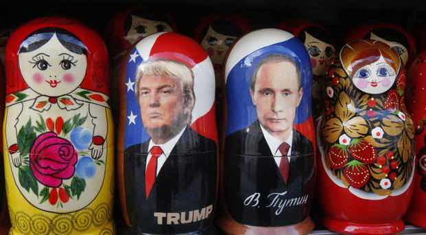 Traditional Russian Matryoshka dolls depicting Russian president Vladimir Putin and US leader Donald Trump (AP)
