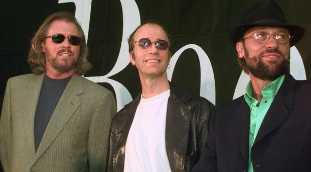 Barry, Robin and Maurice Gibb, pictured in 1998 (AP)